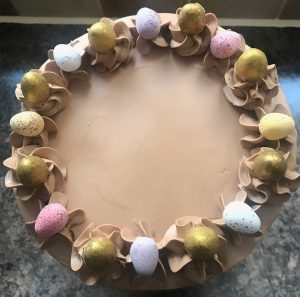 Easter surprise cake, surprise chamber, mini eggs, golden eggs, close up shot, top view