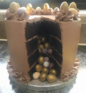 aster surprise cake, surprise chamber, mini eggs, golden eggs, close up shot