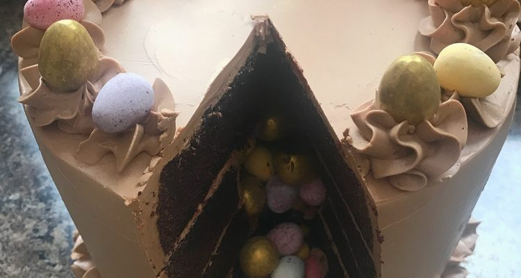 aster surprise cake, surprise chamber, mini eggs, golden eggs, close up shot, top view
